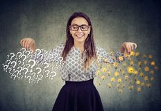 Happy young woman with many questions and answers ideas light bulbs stock photos