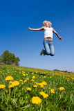 Happy young woman on meadow Royalty Free Stock Photography