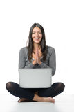 Happy young woman meditating with her laptop Stock Photo