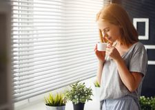 Happy Young Woman Meets Morning With Cup Of Coffee At Wind Stock Photography