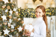 Happy young woman on morning at Christmas tree with gifts Royalty Free Stock Photography