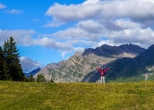 Happy young woman in the mountains. Happy young woman spreading hands with joy and inspiration in the mountains. Mont Blanc Stock Image