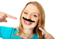 Happy young woman with a moustache Stock Photography