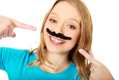 Happy young woman with a moustache Stock Photo