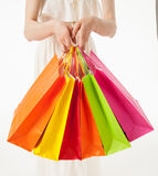 Happy young woman with multicolored shopping bags Royalty Free Stock Photo