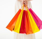 Happy young woman with multicolored shopping bags Stock Photography