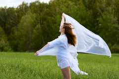Happy young fashion woman walking on nature Royalty Free Stock Images