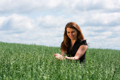 Happy young woman on nature Stock Photography