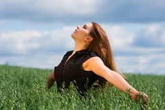 Happy young woman relaxing on nature Stock Photo