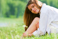 Happy young woman on nature Stock Photo