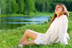 Happy young woman on nature Stock Image