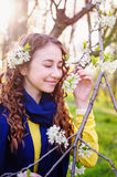 Happy young woman near a flowering tree in the Park.  Stock Images
