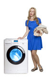 The happy young woman near the new washing machine Royalty Free Stock Images
