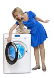 The happy young woman near the new washing machine Stock Images