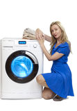 The happy young woman near the new washing machine Stock Photography