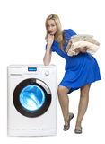 The happy young woman near the new washing machine Stock Photos