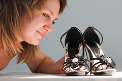 Happy young woman with new shoes stock photos