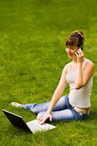 Happy young woman with notebook and mobile phone Stock Images