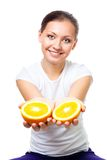 Happy young woman offer orange Stock Image