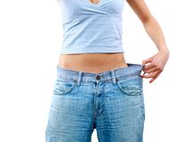 Happy young woman in old jeans Stock Images