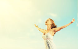 Happy young woman open her arms to the sky Royalty Free Stock Image