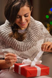 Happy young woman opening Christmas present box Stock Photo