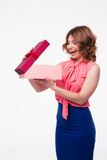 Happy young woman opening gift box Royalty Free Stock Images