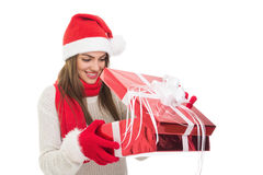 Happy young woman opening a gift Stock Photography