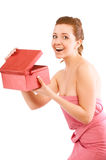 Happy young woman opening a red gift box Royalty Free Stock Photography