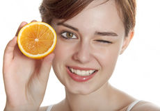 Happy young woman with orange Royalty Free Stock Photography