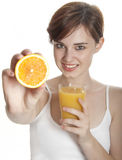 Happy young woman with orange juice Royalty Free Stock Photography