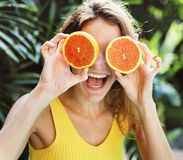 Happy young woman with oranges royalty free stock image