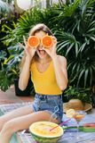 Happy young woman with oranges Royalty Free Stock Images