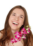 Happy young woman with orchids isolated Stock Photos