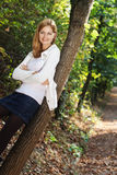 Happy young woman outdoors in the park Stock Photo