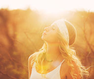 Happy Young Woman Outdoors at Susnet. Fashion Lifestyle. Stock Photography
