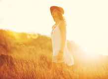 Happy Young Woman Outdoors at Susnet. Fashion Lifestyle. Royalty Free Stock Images