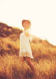 Happy Young Woman Outdoors at Susnet. Fashion Lifestyle. Stock Photos