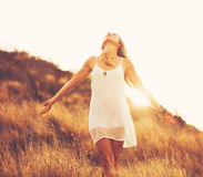 Happy Young Woman Outdoors at Susnet. Fashion Lifestyle. Stock Image
