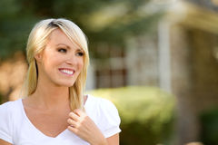 Happy Young Woman Outside. Smiling young blonde woman outside stock photography