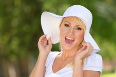 Happy Young Woman Outside. A happy young woman outside in nature royalty free stock images