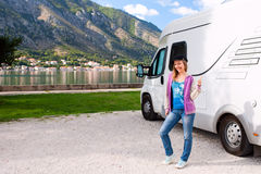 Happy young woman outside motorhome Royalty Free Stock Image