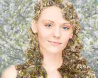 Happy young woman over blooming tree pattern Royalty Free Stock Photo