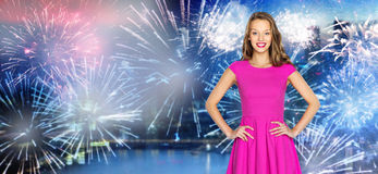 Happy young woman over firework at night city Royalty Free Stock Photography