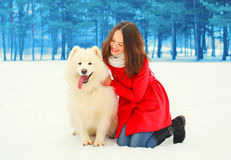 Happy young woman owner with white Samoyed dog winter Stock Photography