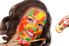 Happy young woman painting Easter eggs Royalty Free Stock Photography