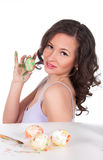 Happy young woman painting Easter eggs Royalty Free Stock Images