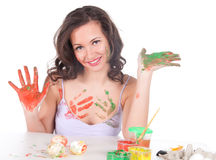 Happy young woman painting Easter eggs Stock Photos