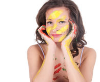 Happy young woman painting herself Royalty Free Stock Photo