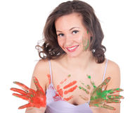 Happy young woman painting herself Royalty Free Stock Image